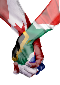 Canadian South African holding hands